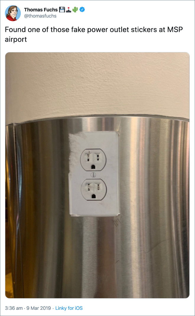 Found one of those fake power outlet stickers at MSP airport