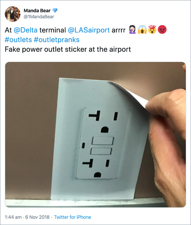 Fake power outlet sticker at the airport