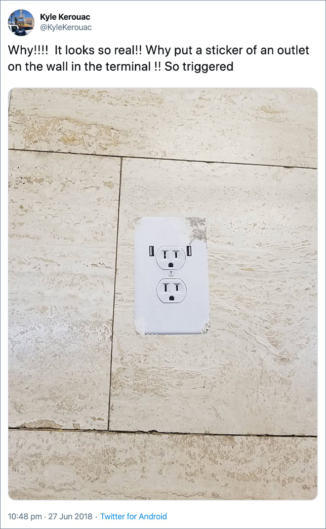 Why!!!! It looks so real!! Why put a sticker of an outlet on the wall in the terminal !! So triggered