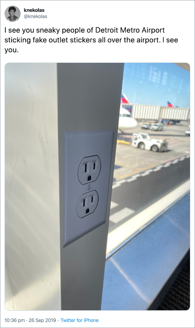 I see you sneaky people of Detroit Metro Airport sticking fake outlet stickers all over the airport. I see you.